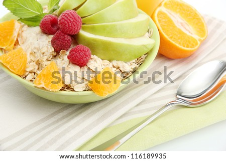 tasty oatmeal with raspberry and fruits, close up
