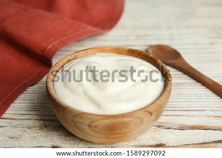 Tasty organic yogurt on white wooden table ストックフォト ©