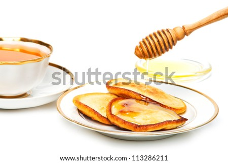 Tasty pancakes with honey and tea