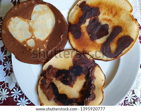tasty pancakes with romantic pictures