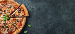 Tasty pepperoni pizza with mushrooms and olives. Top view with copy space. Banner.