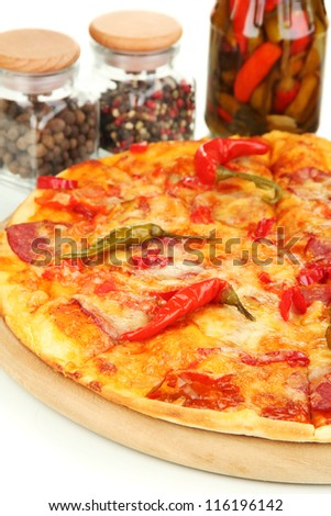Tasty pepperoni pizza with vegetables on wooden board close-up