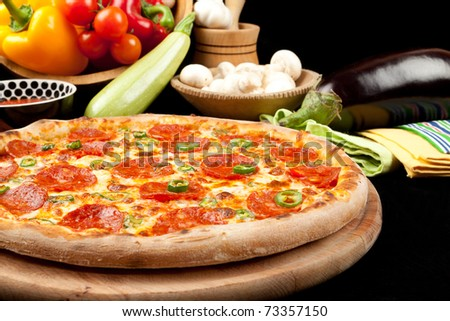 Tasty pizza with salami and pepper