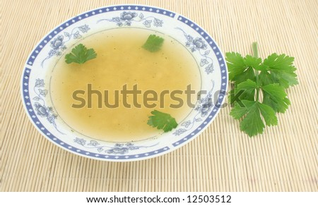 tasty plate of soup with celery