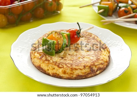 tasty potatoes omelette with grilled vegetable skewer
