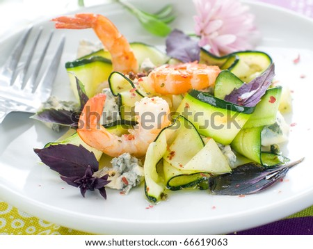 tasty prawns appetizer with zucchini, cheese and basil