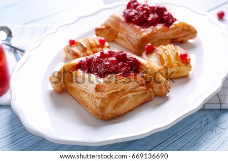 Tasty puff pastry dessert on plate #669136690