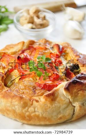 tasty quiche with salami, tomato and zucchini
