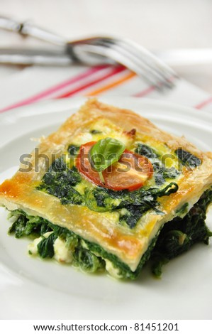 tasty quiche with spinach and tomato, spanakopita