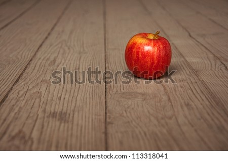 Tasty red apple on table; agriculture background image - organic food production