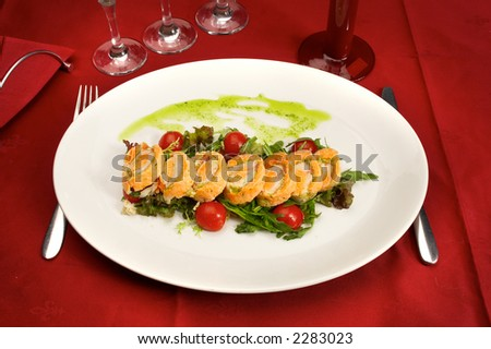 Tasty red fish with salad and tomatoes...