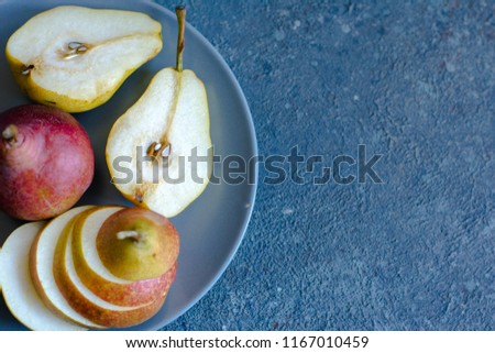Tasty ripy juicy colorful juicy pears on blue cement background #1167010459