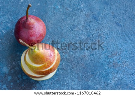 Tasty ripy juicy colorful juicy pears on blue cement background #1167010462