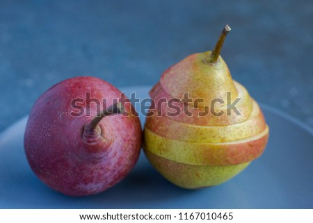 Tasty ripy juicy colorful juicy pears on blue cement background #1167010465