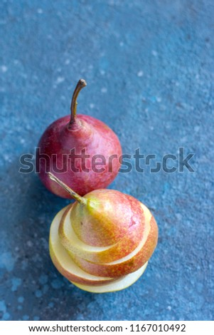 Tasty ripy juicy colorful juicy pears on blue cement background #1167010492