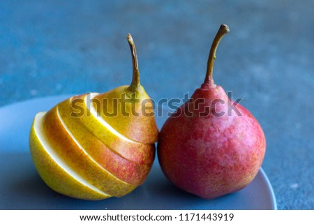 Tasty ripy juicy colorful juicy pears on blue cement background #1171443919