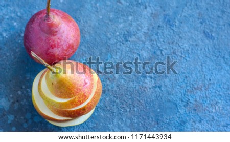 Tasty ripy juicy colorful juicy pears on blue cement background #1171443934