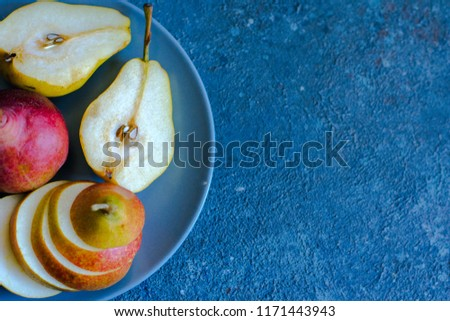 Tasty ripy juicy colorful juicy pears on blue cement background #1171443943