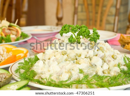 Tasty Russian salad. Banquet in the restaurant. Focused on one dish