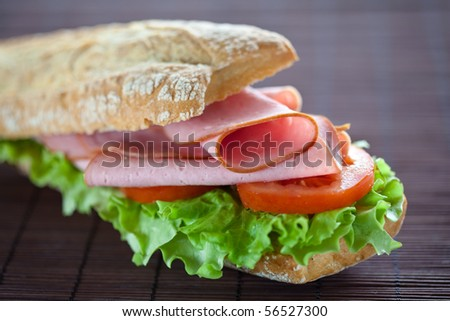 tasty sandwich of ham lettuce and tomato