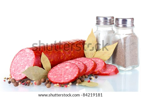 Tasty sausage and spices isolated on white