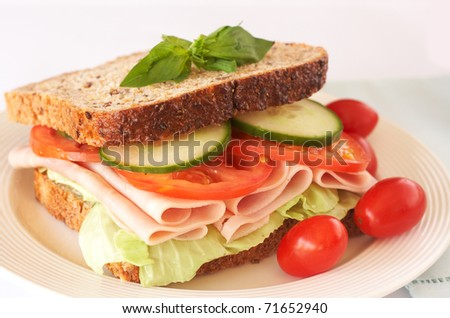 Tasty smoked ham, tomato and cucumber sandwich on wholewheat bread