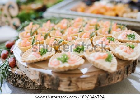 Tasty snacks kanapes on the buffet table Stock fotó ©