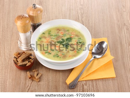 Tasty soup on wooden background - stock photo