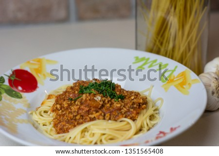 Tasty spaghetti bolognese on kitchen table