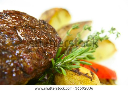 Tasty steak with potato and grilled vegetables