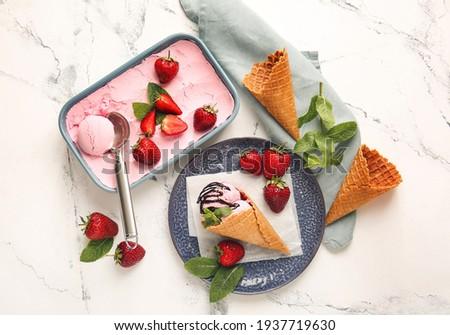 Tasty strawberry ice cream on white background