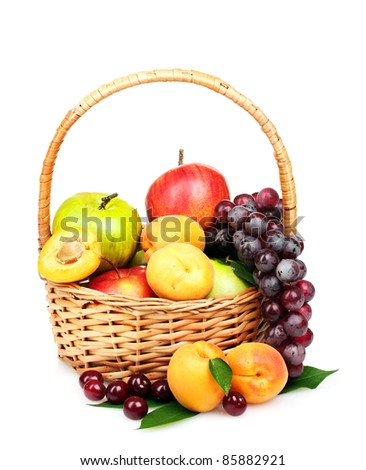 tasty summer fruits in backet isolated on white