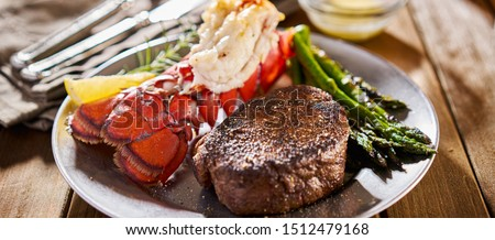 tasty surf & turf steak and lobster meal with asparagus on dinner plate Сток-фото ©