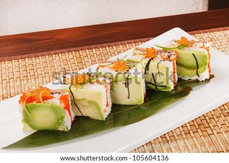 tasty sushi with avocado