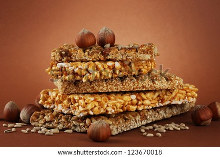 tasty sweets (kozinaki), on brown background