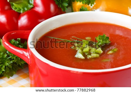 Tasty tomato soup with green paprika and herbs.