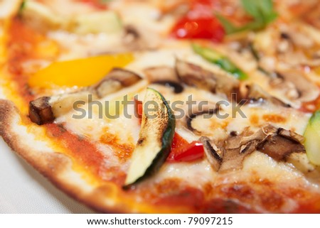 Tasty vegetable pizza close-up, selective focus, macro