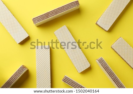 Tasty wafer sticks on yellow background, flat lay. Sweet food #1502040164