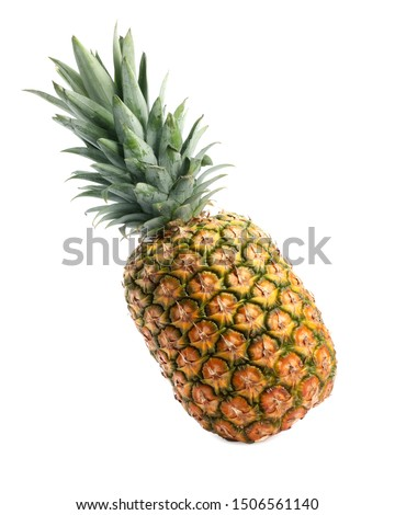 Tasty whole pineapple with leaves on white background stock photo