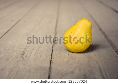 Tasty yellow pear on table; agriculture background image - organic food production