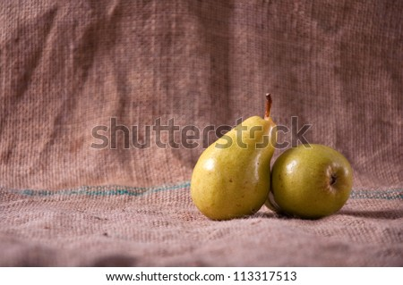 Tasty yellow pears on table; agriculture background image - organic food production