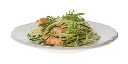 Tasty zucchini pasta with shrimps and arugula isolated on white