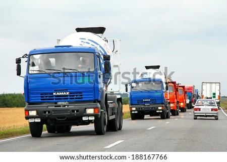 TATARSTAN, RUSSIA - AUGUST 20, 2011: Brand new KAMAZ construction trucks at the interurban road.
