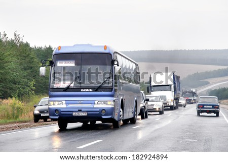 TATARSTAN, RUSSIA - AUGUST 20, 2011: Purple Hyundai Aero Express Hi-Class interurban coach at the interurban road. #182924894
