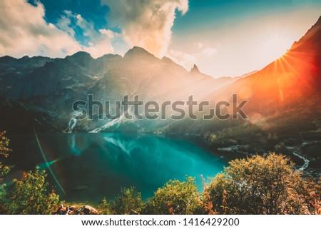 Tatra National Park, Poland. Famous Mountains Lake Morskie Oko Or Sea Eye Lake In Summer Evening. Beautiful Sunset Sun Sunshine Sunrays Above Tatras Lake Landscape. UNESCO's World Network of Reserves Stock fotó ©