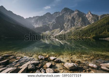 Tatra National Park, Poland. Famous Mountains Lake Morskie Oko Or Sea Eye Lake In Summer Morning Sunrise. Beautiful Sunrays Above Tatras Lake Landscape. UNESCO's World Network of Reserves Stock fotó ©