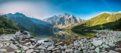 Tatra National Park, Poland. Panorama Famous Mountains Lake Morskie Oko Or Sea Eye Lake In Summer Morning. Five Lakes Valley. Beautiful Scenic View. UNESCO's World Network of Biosphere Reserves