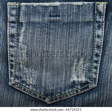 Tattered jeans pocket.