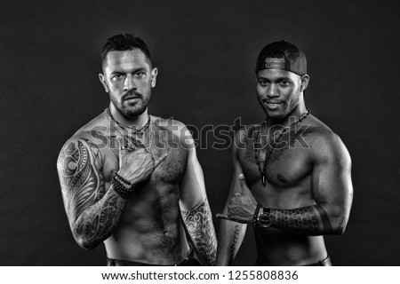 Tattoo brutal attribute. Men brutal attractive hispanic appearance tattooed body. Bearded men show tattooed torso. Masculinity and brutality. Brutal strict macho with tattoos. Tattoo culture concept.