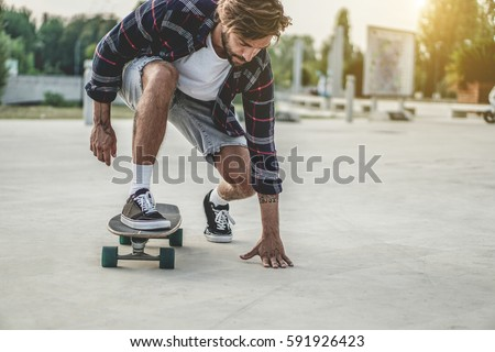 tattoo skater performing with...